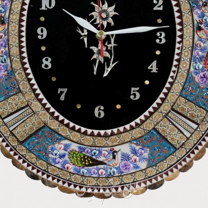 ساعت دیواری بیضی تلفیق هنر قلمزنی مینیاتور و خاتمکاری